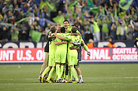 Fredy Montero (17 )of the Seattle Sounders FC celebrates with teammates. The Seattle Sounders FC defeated the Columbus Crew 2-1 during the US Open Cup Final at Qwest Field in Seattle,WA, on October 5, 2010.