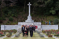 people walk away from the Cross of Sacrifice after the Remembrance Sunday ceremony at the Hodogaya, Commonwealth War Graves Cemetery in Hodogaya, Yokohama, Kanagawa, Japan. Sunday November 12th 2017. The Hodagaya Cemetery holds the remains of more than 1500 servicemen and women, from the Commonwealth but also from Holland and the United States, who died as prisoners of war or during the Allied occupation of Japan. Each year officials from the British and Commonwealth embassies, the British Legion and the British Chamber of Commerce honour the dead at a ceremony in this beautiful cemetery.