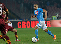 Gokhan Inler   in action during the Italian Serie A soccer match between SSC Napoli and AS Roma   at San Paolo stadium in Naples, March 09 , 2014