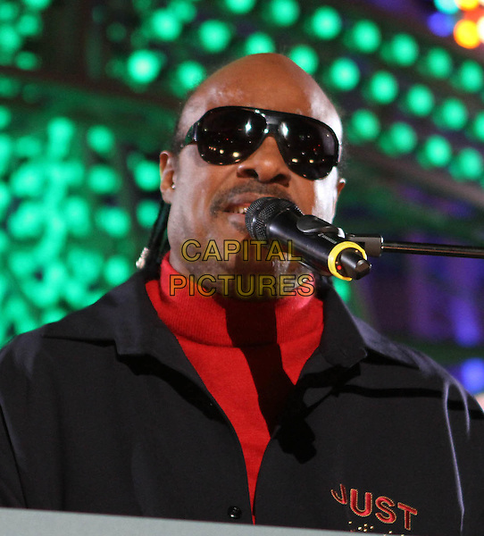 STEVIE WONDER .The Holiday Tree Lighting At L.A. Live & Opening Of L.A. Kings Holiday Ice held At L.A Live,  Los Angeles, CA, USA, .4th December 2010..music concert live on stage gig portrait headshot  sunglasses black red microphone singing polo neck .CAP/ADM/KB.©Kevan Brooks/AdMedia/Capital Pictures.