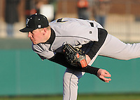 Pitcher Matthew Milburn (24) of the Wofford Terriers pitches in the sixth inning of a game against the Clemson Tigers on Wednesday, March 6, 2013, at Doug Kingsmore Stadium in Clemson, South Carolina. Clemson won, 9-2. (Tom Priddy/Four Seam Images)