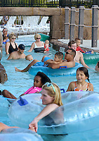 NWA Democrat-Gazette/BEN GOFF @NWABENGOFF<br /> Visitors float the lazy river on Sunday Sept. 6, 2015 at the Rogers Aquatic Center. The water park will be open for the last day of the 2015 season on Monday from 11:00a.m. to 7:00p.m.