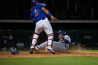 AZL Royals Herard Gonzalez (2) slides under the tag from catcher Henderson Perez (8) during an Arizona League game against the AZL Cubs 1 on June 30, 2019 at Sloan Park in Mesa, Arizona. AZL Royals defeated the AZL Cubs 1 9-5. (Zachary Lucy/Four Seam Images)