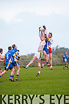 An Ghaeltacht Micheal Breathnach and Dara Ó Sé in a piece of fielding against Keel Thomas Ladden during the County League Div. 3 match at Gallarus on Sunday afternoon.