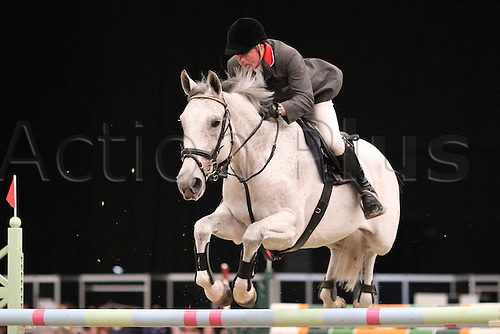 10.10.2010 The Horse of the Year Show from the NEC in Birmingham. HOYS leading Showjumper of the year. John Whitaker riding Dazzle II