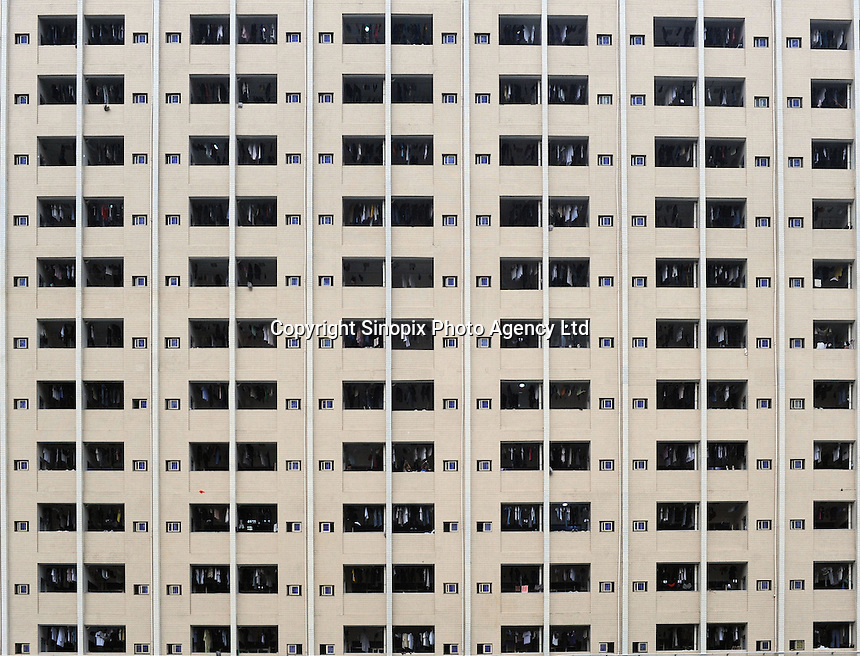 Workers in the Weilong dormitory belonging to Foxconn, Longhua, Shenzhen which has been fitted with steel wire mesh to stop workers jumping from the windows. The Foxconn factory in Longhua, near Shenzhen. Foxconn is Apple's major supplier and the Shenzhen plant employ 420,000 workers. There have been a rash of at leat 10 suicides in 2010 believed to be due to harsh management practices..