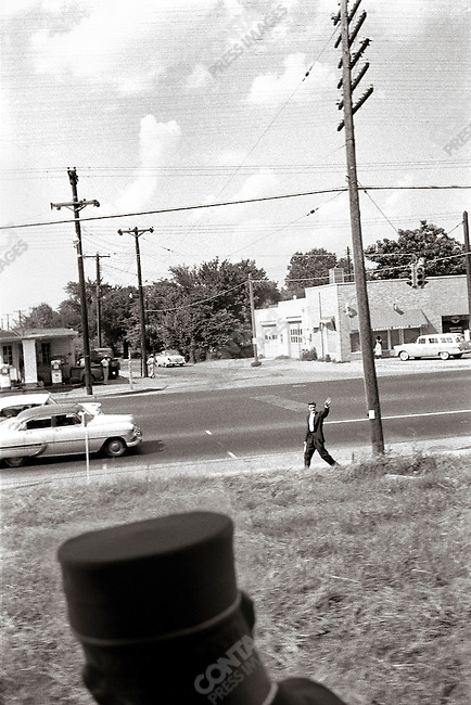 Elvis gets off of the train to go to his parents' home, Memphis, Tennessee, USA, July 4, 1956