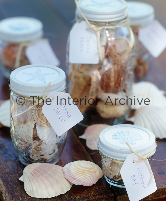 Jars filled with shells have been labelled with the beach where they were originally found