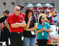 Apr 10, 2015; Las Vegas, NV, USA; Special guests watch as NHRA top fuel driver Steve Torrence backs up after his burnout during qualifying for the Summitracing.com Nationals at The Strip at Las Vegas Motor Speedway. Mandatory Credit: Mark J. Rebilas-