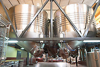 The winery with many big stainless steel fermentation tanks. Unusual conic shaped bottom to make it easier to remove the lees. Bodega Familia Schroeder Winery, also called Saurus, Neuquen, Patagonia, Argentina, South America