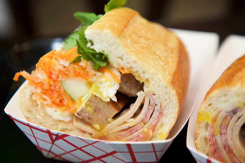 Queens, NY - August 9, 2017: JoJu, serving Modern Vietnamese Sandwiches in Elmhurst. A stop on a tour of Queens food vendors curated by Joe DiStefano to serve at The Meadows Festival in September. <br /> <br /> <br /> Credit: Clay Williams.<br /> <br /> &copy; Clay Williams / http://claywilliamsphoto.com