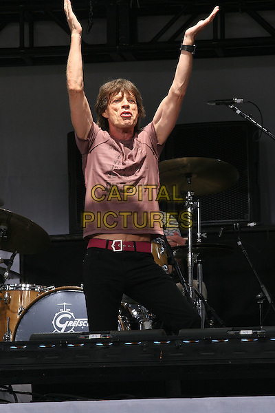 MICK JAGGER.The Rolling Stones Kick Off World Tour with Surprise Performance, Julliard Music School Plaza, New York City, USA, May 10th 2005..half length concert gig  funny pose arms raised up.Ref: IW.www.capitalpictures.com.sales@capitalpictures.com.©Ian Wilson/Capital Pictures.