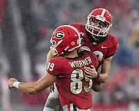 ATHENS, GA - NOVEMBER 23: Rodrigo Blankenship #98 and Charlie Woerner #89 of the Georgia Bulldogs celebrate a field goal during a game between Texas A