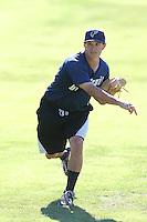Jerad McCrummen #26 of the Tri-City Dust Devils throws before a game against the Everett AquaSox at Everett Memorial Stadium on July 29, 2014 in Everett, Washington. Everett defeated Tri-City, 7-5. (Larry Goren/Four Seam Images)
