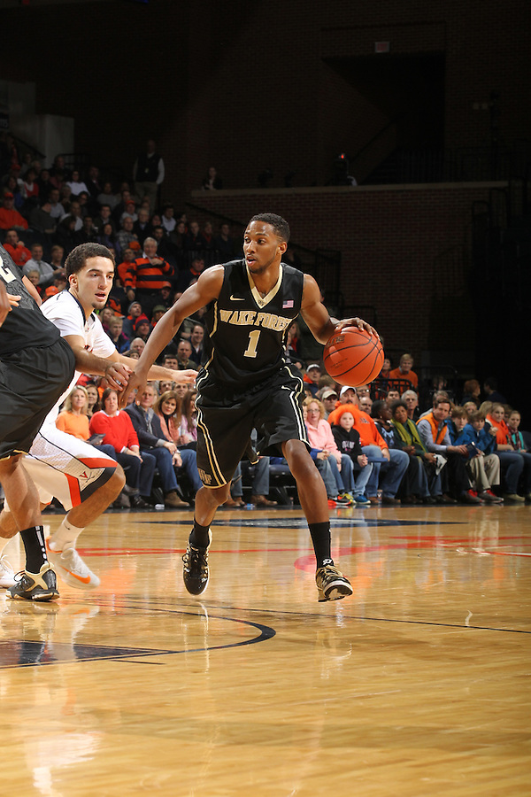 Wake Forest guard Madison Jones (1) handles the ball during the game against Virginia Wednesday Jan. 08, 2014 in Charlottesville, Va. Virginia defeated Wake Forest 74-51.