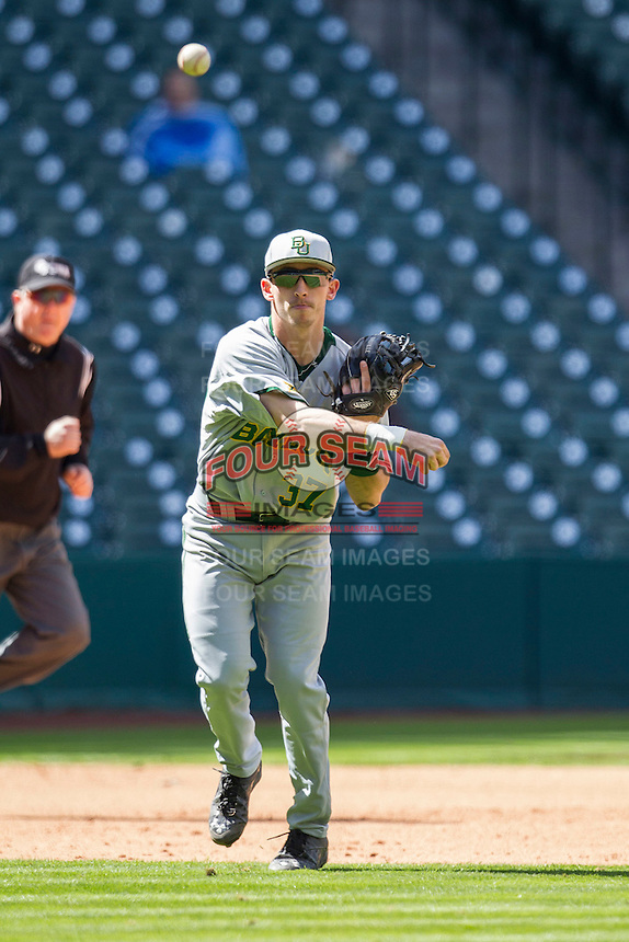 Baylor Bears third baseman Jonathan Ducoff (37) makes a throw to first base during Houston College Classic against the Hawaii Rainbow Warriors on March 6, 2015 at Minute Maid Park in Houston, Texas. Hawaii defeated Baylor 2-1. (Andrew Woolley/Four Seam Images)