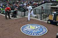 Pitcher Tyler Badamo (16) of the Columbia Fireflies is introduced to the crowd before the home opener against the Greenville Drive on Thursday, April 14, 2016, their first day at the new Spirit Communications Park in Columbia, South Carolina. The Mets affiliate moved to Columbia this year from Savannah. Columbia won, 4-1. (Tom Priddy/Four Seam Images)