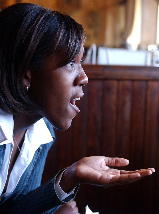 Newsday reporter, Cynthia Daniels, during interview with Cathy Heighter of Bay Shore whose son Raheen Heighter was the first Long Islander KIA in Iraq two years ago, at the Milk and Sugar Cafe in Bay Shore on Thursday October 27, 2005. (Photo / Jim Peppler).