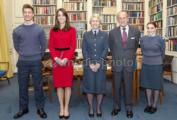 16 December 2015 - London, England - Cadet Sergeant Tommy Dade (far left) and Cadet Sergeant Bronwyn Jacobs (far right) stand with Prince Philip the Duke of Edinburgh (second right) as he meets Air Commodore, Dawn McCafferty, Commandant of the Air Cadet organisation (centre) at Buckingham Palace in London, as he retired from the post of Air Commodore in Chief and on the occasion of the Kate Duchess of Cambridge Catherine Katherine Middleton (second left) becoming Honorary Air Commandant of the Air Cadets. Photo Credit: Alpha Press/AdMedia