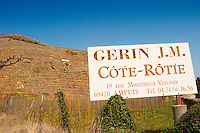 Old sign saying Gerin J.M. Cote Rotie. Terraced vineyards in the Cote Rotie district around Ampuis in northern Rhone planted with the Syrah grape. Ampuis, Cote Rotie, Rhone, France, Europe