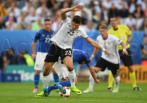 02.07.2016. Bordeaux, France.  Germany's Mario Gomez is tangled up during the UEFA EURO 2016 quarter final  match between Germany and Italy at the Stade de Bordeaux in Bordeaux, France, 02 July 2016.