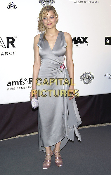 MARION COUILLTARD.arrivals at  amfAR 's Cinema Against Aids 2004.at Le Moulin de Mougins .Cannes Film Festival, France 20 May 2004..full length curly hair grey satin wrap around over dress  pink flower broach.sales@capitalpictures.com.www.capitalpictures.com.©Capital Pictures