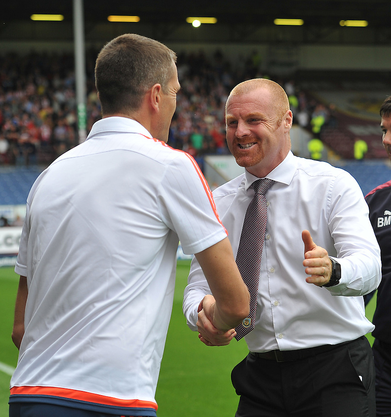 Burnley's Manager Sean Dyche greets Brentford's Manager Marinus Dijkhuizen<br /> <br /> Photographer Dave Howarth/CameraSport<br /> <br /> Football - The Football League Sky Bet Championship - Burnley v Brentford - Saturday 22nd August 2015 - Turf Moor - Burnley<br /> <br /> &copy; CameraSport - 43 Linden Ave. Countesthorpe. Leicester. England. LE8 5PG - Tel: +44 (0) 116 277 4147 - admin@camerasport.com - www.camerasport.com