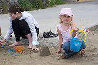 Nadine helping (off camera) Safina build a sandcastle whilst Morgan displays one she built