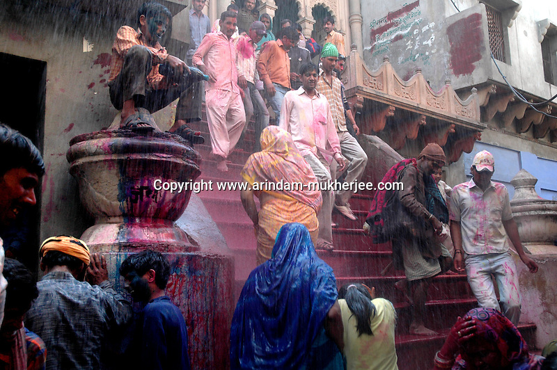 Visitors and devotees are greeted by water from the roof of the Krishna temple by the locals at Nandgaon 5 kms away from Barsana on the 2nd day of lathmar holi, Uttar Pradesh, India . Lathmar holy is celibrated 7 days before the actual holi day.