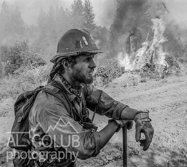September 3, 1987 Pine Mountain Lake, California -- Stanislaus Complex Fire -- Fire Captain Mike Lanier takes a moment to think about how much more work his crew still has to do. The Stanislaus Complex Fire consumed 28 structures and 145,980 acres.  One US Forest Service firefighter, David Ross Erickson, died from a tree-felling accident.