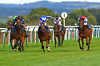 Winner of The Irish Stallion Farms EBF Fillies' Nursery Handicap Stakes Cotubanama (red cap right) ridden by Nicola Currie and trained by Mick Channon  during Twilight Racing at Salisbury Racecourse on 14th September 2018