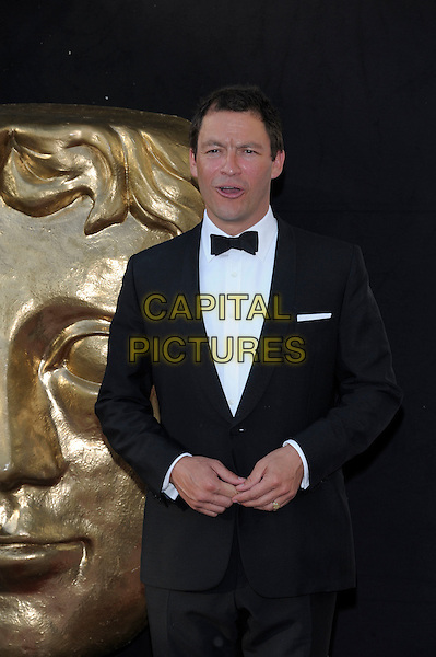 Dominic West.Arrivals at the Arqiva British Academy Television Awards held at the Royal Festival Hall, London, England..May 27th, 2012.BAFTA BAFTAS half length black white tuxedo mouth open.CAP/PL.©Phil Loftus/Capital Pictures.