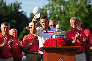 Bethesda, MD - June 29, 2014: Justin Rose acknowledges the crowd while at the podium about to receive the Quicken Loan National trophy at Congressional Country Club in Bethesda MD. The win gives Rose a total of six PGA Tour titles. (Photo by Phillip Peters/Media Images International)