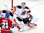 9 January 2010: New Jersey Devils' goaltender Martin Brodeur makes a third period save against the Montreal Canadiens at the Bell Centre in Montreal, Quebec, Canada. The Devils edged out the Canadiens 2-1 in overtime. Mandatory Credit: Ed Wolfstein Photo