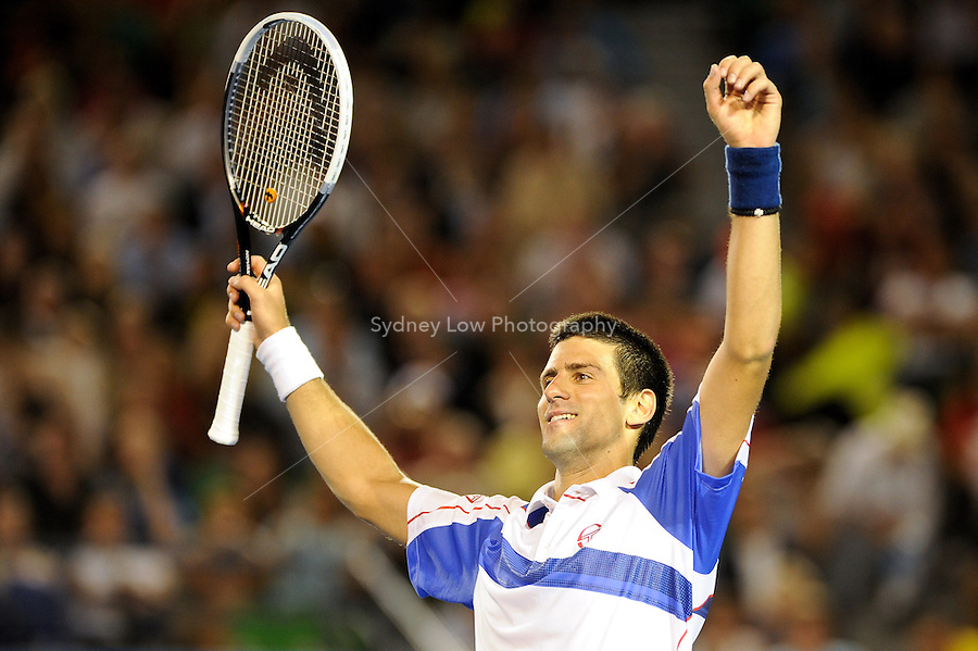 MELBOURNE, 27 JANUARY - Novak Djokovic (SRB) celebrates his win over Roger Federer (SUI) in the semi final match on day eleven of the 2011 Australian Open at Melbourne Park, Australia. (Photo Sydney Low / syd-low.com)