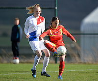 20140209 - TUBIZE , BELGIUM : Belgian Lola Wajnblum (r) pictured in front of Dutch Danique Kerkdijk (4) during a friendly soccer match between the Under 19 ( U19) women teams of Belgium and The Netherlands , Sunday 9 February 2014 in Tubize . PHOTO DAVID CATRY
