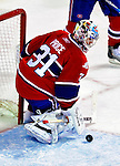 31 March 2010: Montreal Canadiens' goaltender Carey Price makes a second period save against the Carolina Hurricanes at the Bell Centre in Montreal, Quebec, Canada. The Hurricanes defeated the Canadiens 2-1 in their last meeting of the regular season. Mandatory Credit: Ed Wolfstein Photo