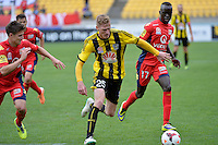 Shaun Timmins and Awer Mabil during the A League - Wellington Phoenix v Adelaide United, Wellington, New Zealand on Sunday 30 March 2014. <br /> Photo by Masanori Udagawa. <br /> www.photowellington.photoshelter.com.