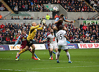 Sunday, 26 April 2014<br /> Pictured:Aston Villa goalkeeper Brad Guzam (yellow) grabs the ball from a Swansea corner kick. <br /> Re: Barclay's Premier League, Swansea City FC v Aston Villa at the Liberty Stadium, south Wales.