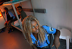 An Israeli prison guard from Ethiopian descent, sits with Eritrean women at their caravan room, in a women-children detention facility within Ketziot Prison compound, designated for African asylum-seekers who have illegally crossed the nearby Egyptian-Israeli border.