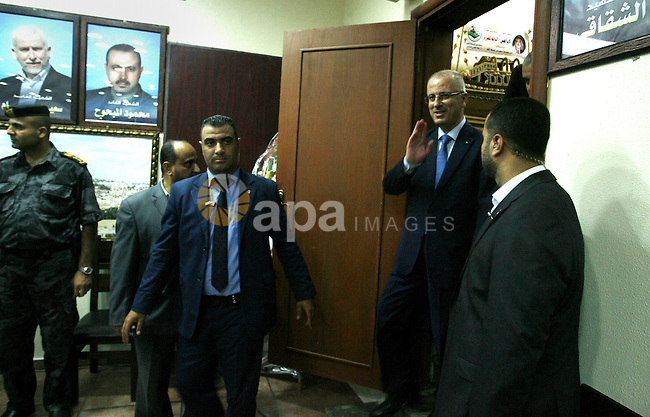 Palestinian Prime Minister Rami Hamdallah arrives during his visit to the senior Hamas leader Ismail Haniyeh, at Haniyeh's house in Gaza city on October 9, 2014. The Palestinian unity government which took the oath of office in June under technocrat prime minister Rami Hamdallah arrived to Gaza Strip on Thursday to convene the first fully meeting. Hamdallah said that the unity government will rebuild the bombed-out Gaza Strip following a seven-week Israeli offensive. Photo by Abed Rahim Khatib