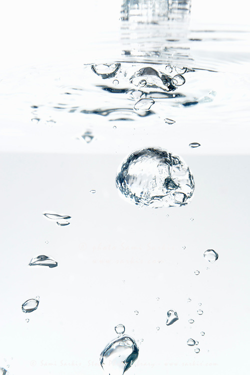Bubbles underwater, white background, studio