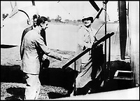 BNPS.co.uk (01202 558833)Pic: QueensFlightArchivesThe Queen Mother and her husband Albert boading a flight in 1934.<br /> <br /> A new book gives an intimate look behind the scenes of the Royal Flight and also the flying Royals.<br /> <br /> Starting in 1917 the book charts in pictures the 100 year evolution of first the King's Flight and then later the Queen's Flight as well as the Royal families passion for aviation.<br /> <br /> Author Keith Wilson has had unprecedented access to the Queen's Flight Archives to provide a fascinating insight into both Royal and aeronautical history.
