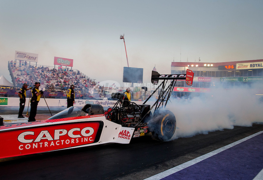 Apr 25, 2014; Baytown, TX, USA; NHRA top fuel dragster driver Steve Torrence during qualifying for the Spring Nationals at Royal Purple Raceway. Mandatory Credit: Mark J. Rebilas-