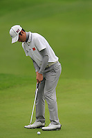 Ouyang Zheng (CHN) putts on the 16th green during Friday's Round 2 of the 2014 BMW Masters held at Lake Malaren, Shanghai, China 31st October 2014.<br /> Picture: Eoin Clarke www.golffile.ie