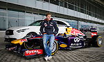 Infiniti Red Bull Racing driver and Formula One triple World Champion Sebastian Vettel of Germany poses for a photograph in front of the Adler Arena Skating Center before he samples the new Russian Grand Prix venue at Sochi Olympic Park on 22 April 2013 in Sochi, Russia. Photo by Victor Fraile / The Power of Sport Images