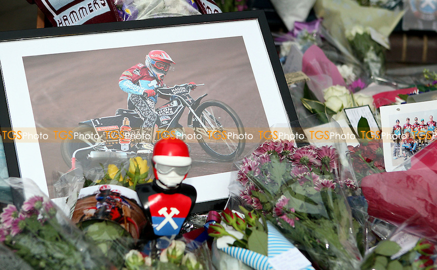 Floral tributes for Lee Richardson - Lakeside Hammers vs Swindon Robins, Elite League Speedway at the Arena Essex Raceway, Pufleet - 18/05/12 - MANDATORY CREDIT: Rob Newell/TGSPHOTO - Self billing applies where appropriate - 0845 094 6026 - contact@tgsphoto.co.uk - NO UNPAID USE..