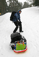 Journalist Marianne Alfsen pulling gear  on a sledge.  All equipment had to be transported on foot about 1,5 km (close to 1 mile) . Freediving competition Oslo Ice Challenge at freshwater lake Lutvann outside the Norwegian capital Oslo.
