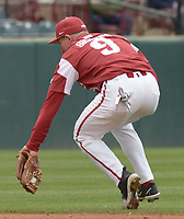 NWA Democrat-Gazette/ANDY SHUPE<br />Arkansas shortstop Jax Biggers makes a backhand stop on a ball hit to the infield Saturday, April 14, 2018, during the third inning against South Carolina at Baum Stadium. Visit nwadg.com/photos to see more photographs from the game.