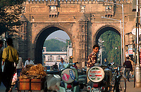 A busy Indian roadway leads through the Tin Darwaza - gate to the city. Ahmedabad, India.
